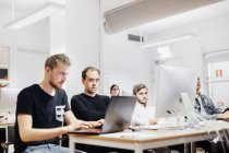 Media students sitting in classroom — Stock Photo