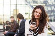 Businesswoman using smart phone — Stock Photo