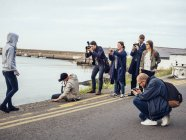 Friends photographing woman — Stock Photo