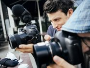 Photographers using digital cameras — Stock Photo
