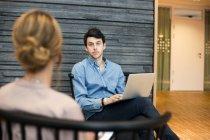 Man looking at woman during meeting — Stock Photo