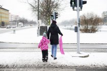 Woman and daughter with sled — Stock Photo