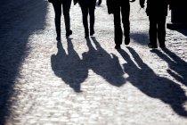 Silhouette people walking on footpath — Stock Photo