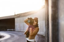 Woman photographing with camera — Stock Photo