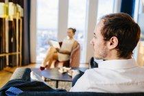 Businessman sitting on sofa — Stock Photo