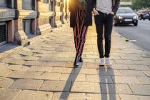 Teenage friends standing on footpath — Stock Photo