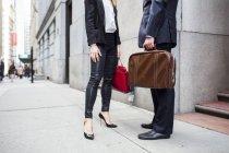 Friends in businesswear standing on sidewalk — Stock Photo