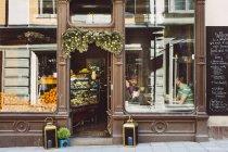 Amis buvant café — Photo de stock