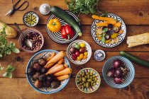 Ingredients in multi colored bowls — Stock Photo