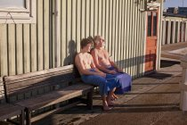 Father and son resting on bench — Stock Photo