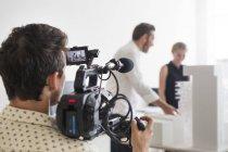Photographer video recording business people — Stock Photo