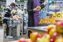 People shopping fruits in supermarket — Stock Photo