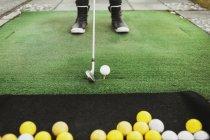 Balle de golf femme visée — Photo de stock