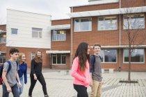 Children in front of school building — Stock Photo