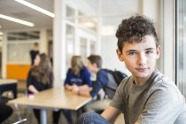 Portrait of schoolboy looking at camera — Stock Photo