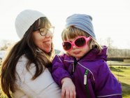 Mother with daughter at park — Stock Photo