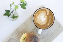Cappuccino and sandwich on table — Stock Photo
