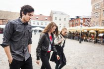 Friends walking at town — Stock Photo