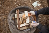 Person igniting firewood — Stock Photo