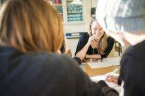 Cropped view of high school students studying at common room — Stock Photo