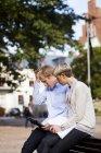 Worried friends using digital tablet — Stock Photo