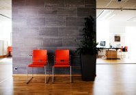 Orange chairs at office lobby — Stock Photo