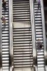 High angle view of people on escalators — Stock Photo