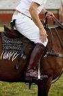 Jockey riding horse on field — Stock Photo
