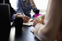 Midsection of business people discussing — Stock Photo
