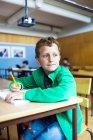 Thoughtful schoolboy looking away — Stock Photo