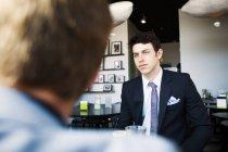 Uomo d'affari premuroso in riunione — Foto stock