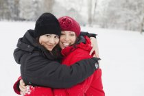 Happy woman hugging friend — Stock Photo