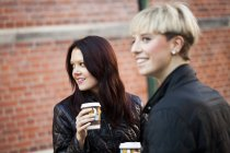 Happy women with coffee cups — Stock Photo