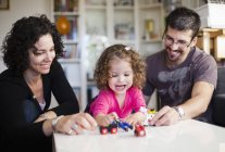 Happy family playing with toys — Stock Photo