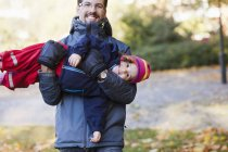 Playful father carrying daughter — Stock Photo
