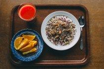 Fresh juice, slices of orange and oatmeal — Stock Photo