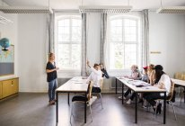 Teacher and Young Students — Stock Photo