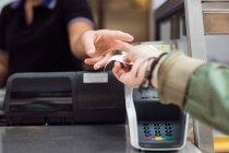 Woman taking receipt — Stock Photo