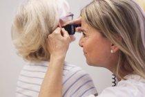 Doctor examining ear — Stock Photo