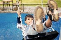 Boy on swing, close-up — Stock Photo
