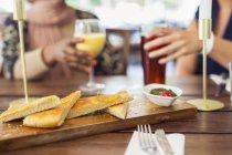 Bread with pesto sauce — Stock Photo