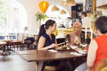 Women during lunch in restaurant — стокове фото