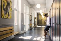 Young Student standing in corridor — Stock Photo