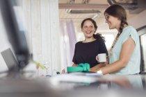 Women smiling in modern office — Stock Photo