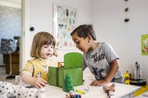 Girl and boy playing with toys — Stock Photo