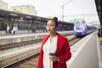 Woman waiting for train — Stock Photo