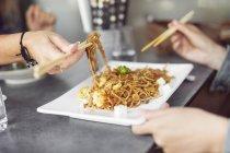 Women eating pasta — Stock Photo