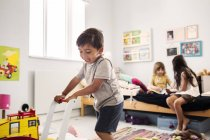Children playing in room — Stock Photo