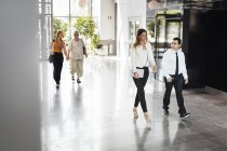 Colleagues walking through lobby — Stock Photo
