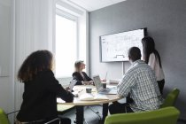 Colleagues discussing blueprint at screen — Stock Photo